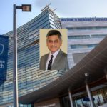 A portrait of Dr. Yatin Vyes is superimposed over an image of the exterior of Hershey Medical Center.