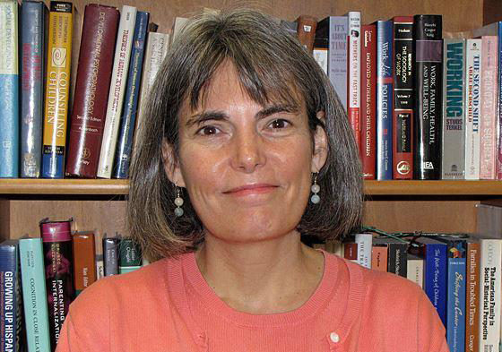 A head-and-shoulders portrait of Susan McHale, PhD, with a shelf of books behind her.